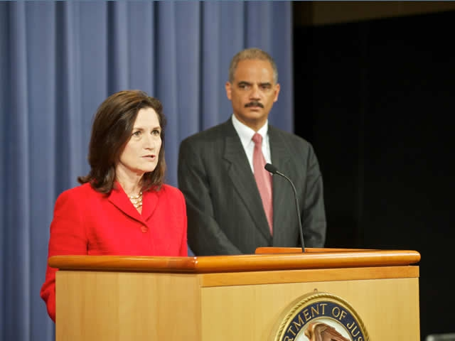 Christine Varney, Assistant Attorney General in charge of the Department of Justice's Antitrust Division at the podium.