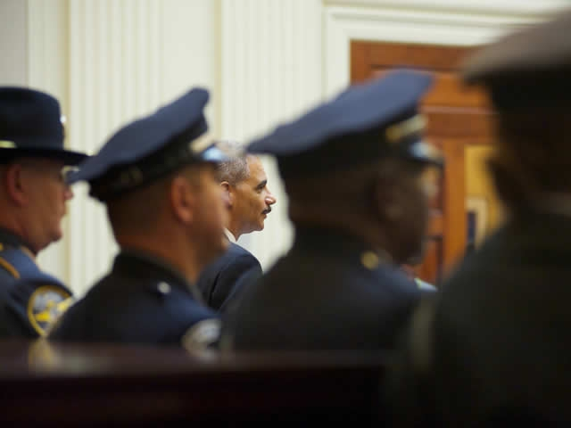 A glimpse of the Attorney General amidst law  enforcement officers attending the groundbreaking ceremony.