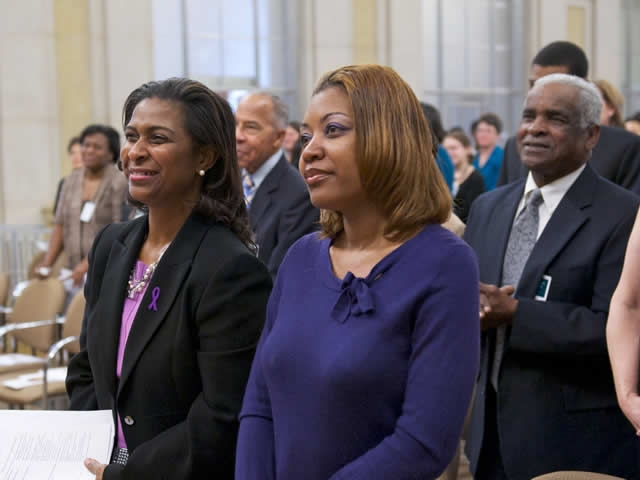 Multiple attendees of the Domestic Violence Awareness panel discussion dress in purple