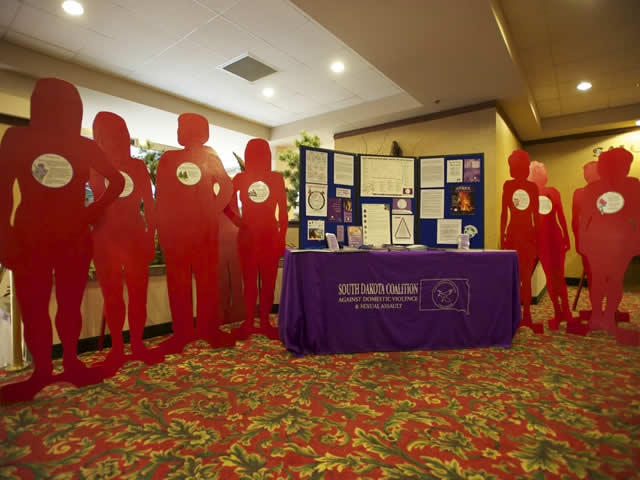 South Dakota Coalition Against Domestic Violence distributes information at the conference of the Attorney General's Advisory Committee Native American Issues Subcommittee in Rapid City, S.D.