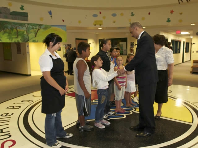 Attorney General Holder meets with children at the SuAnne Big Crow Boys & Girls Club,  Pine Ridge, SD.