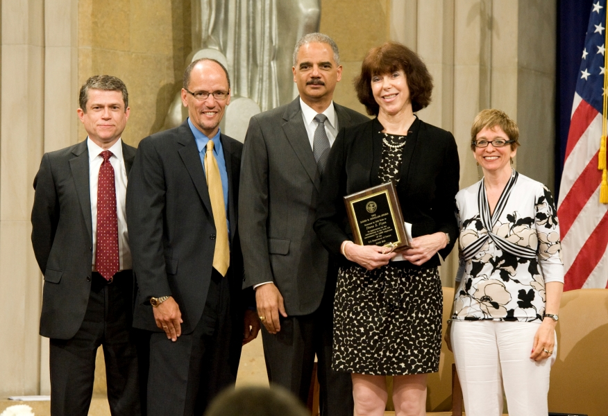 Diana Flynn, Chief of the Appellate Section of the Civil Rights Division in the Department of Justice, receives the James R. Douglass Award, an honor which recognizes individuals whose efforts have positively contributed to the work-life environment for LGBT employees of the Department.