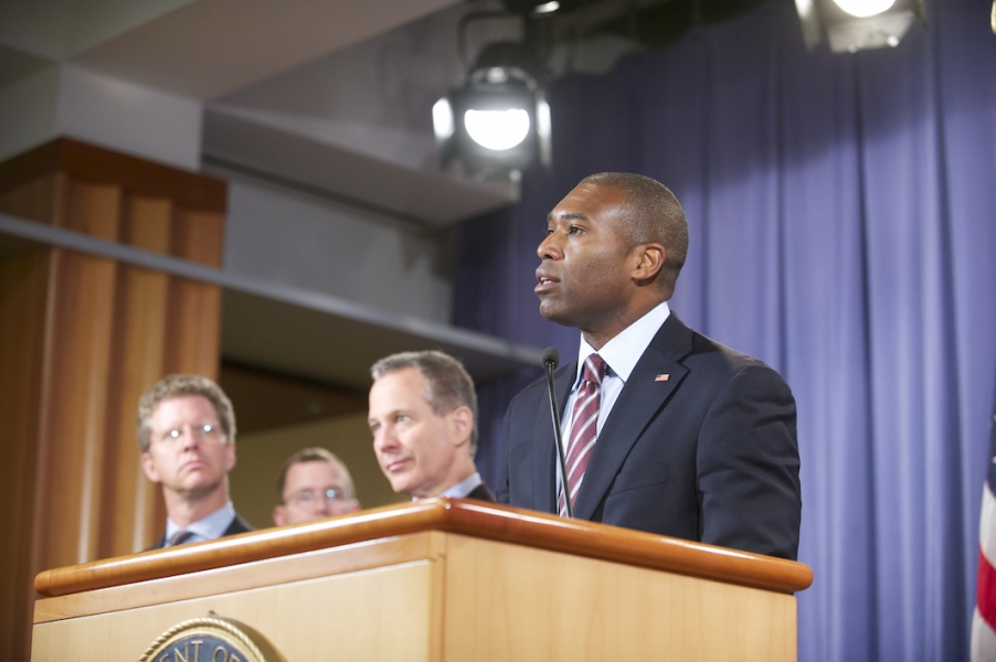 AAG (A) Tony West delivers remarks while HUD Sec Shaun Donovan, AAG Lanny Breuer, and New York  Eric Schneiderman look on.