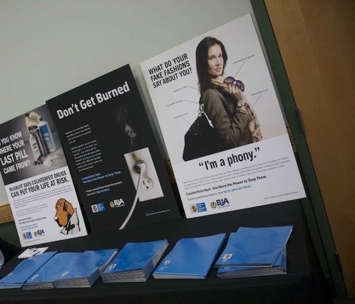 Advertisements on display at the announcement illustrate how easy it is for IP theft to go unnoticed by the consumer.
