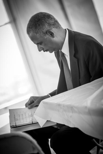 Attorney General Holder prepares to deliver his speech