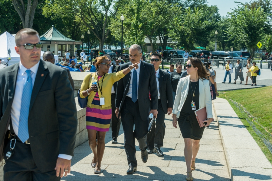 Attorney General Holder joins march participants on the National Mall.
