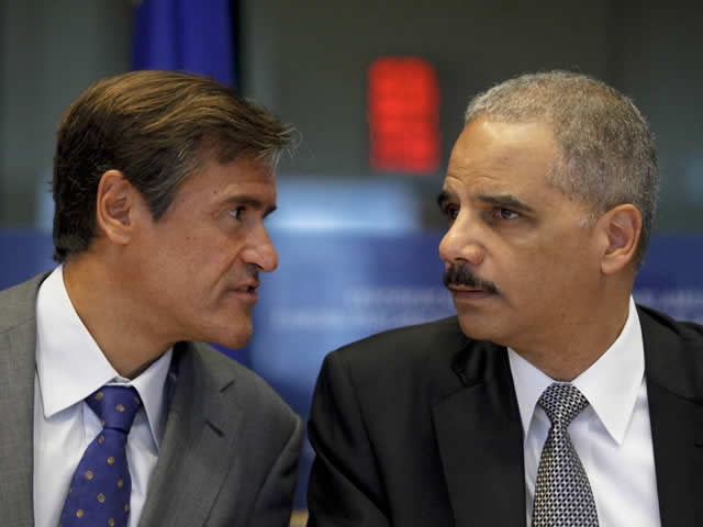 Juan Fernando Lopez Aguilar, Chairman of the European Parliament Committee on Civil Liberties, Justice and Home Affairs speaks with Attorney General Eric Holder during his appearance before the committee.