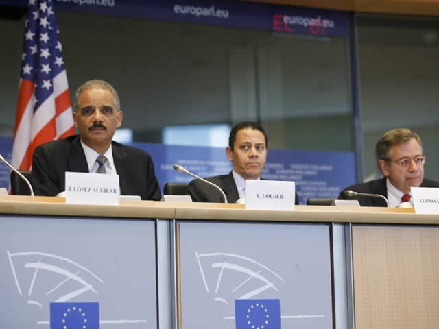 Attorney General Holder sits alongside members of the European Parliament during his appearance  before the Committee on Civil Liverties, Justice and Home Affairs.