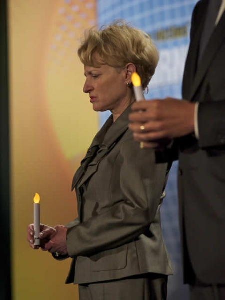 Assistant Attorney General for the Office of Justice Programs Laurie Robinson shows her respect during the Candlelight Ceremony.