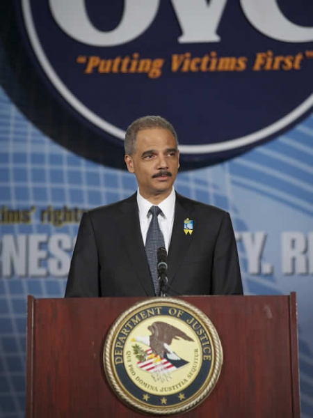 Attorney General Holder addressing the audience at the Candlelight Ceremony.