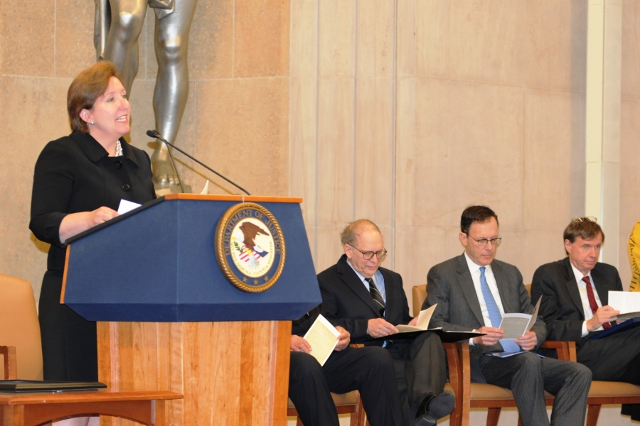 Acting Assistant Attorney General Sharis A. Pozen introduces James F. Rill