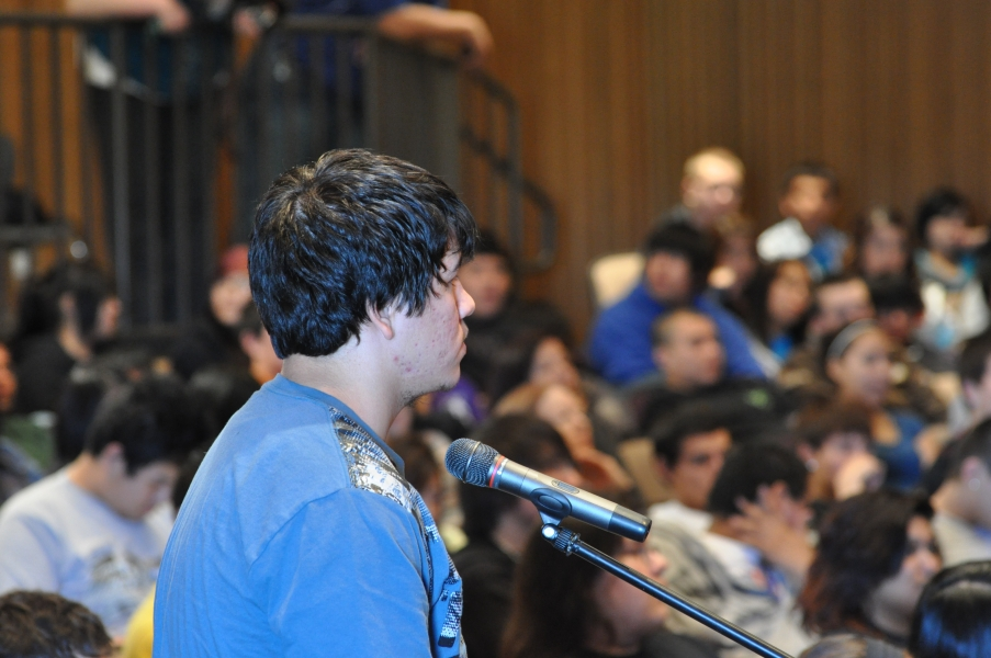 Standing Rock High School Students listen as classmate Jeremy Silva asks questions of Deputy Attorney General Cole..