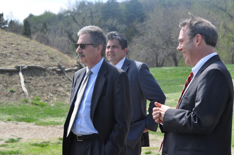 DAG Cole,  AAG Gary Delorme and U.S. Attorney Tim Purdon at the recreated Mandan Village at the Fort Abraham Lincoln State Park