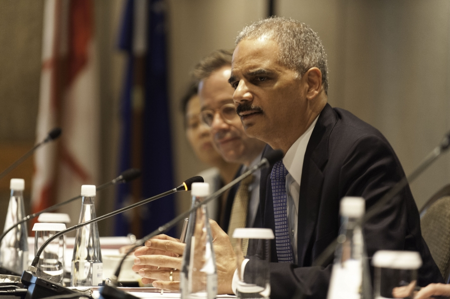 Attorney General Holder speaks during a meeting of Attorneys General