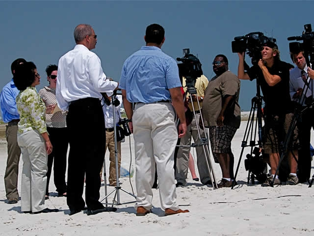 The Attorney General responds to reporters' questions on West End Beach, AL.