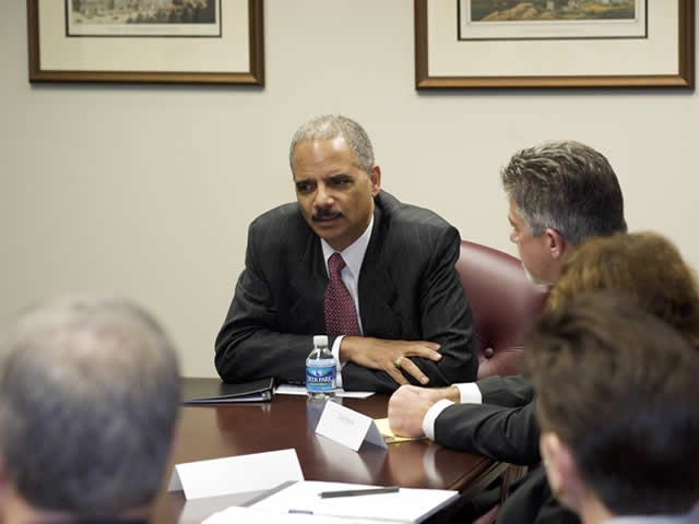 Attorney General Holder, sitting down with EOIR employees.