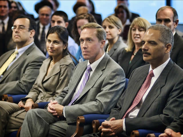 The Attorney General and staff listen to Judge O'Leary.