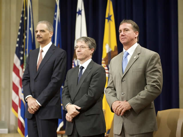 Attorney General  Holder and Deputy Attorney General Ogden stand with Timothy Williams.