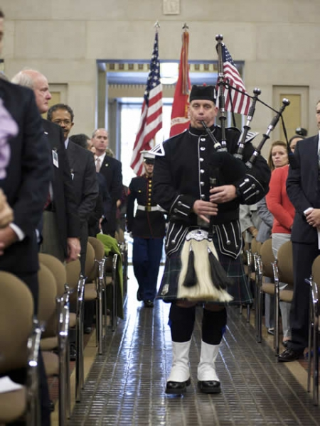 A bagpiper plays during the posting of the colors.