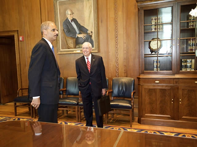Attorney General Holder and former Attorney General Mukasey talk.