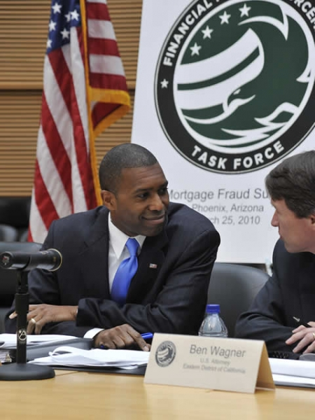 Assistant Attorney General Civil Division, Tony West converses with U.S. Attorney from the Eastern District of California, Ben Wagner before the start of the conference.