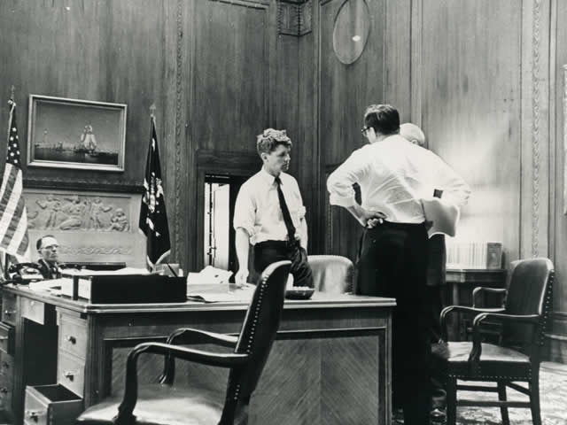 Attorney General Robert F. Kennedy meets with advisors in his office at the Department of Justice.
