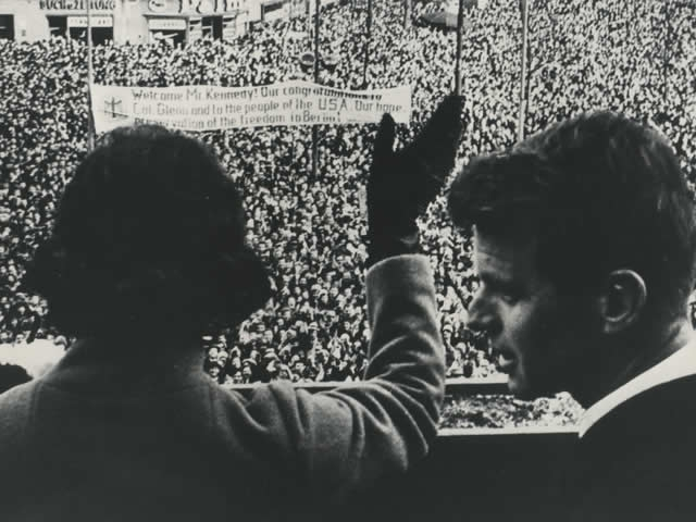 Mrs. Ethel Kennedy waves to the crowd gathered in Berlin. Attorney General Robert F. Kennedy is by her side.