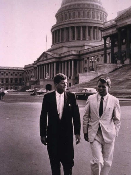 President Kennedy walks from the U.S. Capitol with his brother, Attorney General Robert F. Kennedy