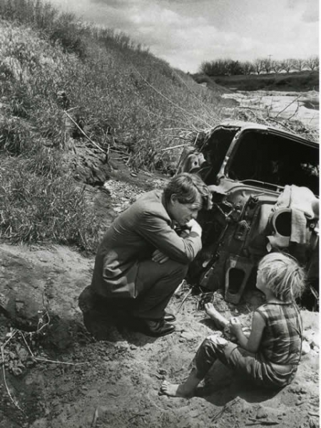 Attorney General Robert F. Kennedy talks with a child during his travels.