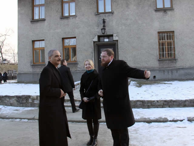 U.S. Attorney General Eric Holder is greeted at the Auschwitz-Birkenau Memorial and State Museum by Museum Director Piotr Cywinski.