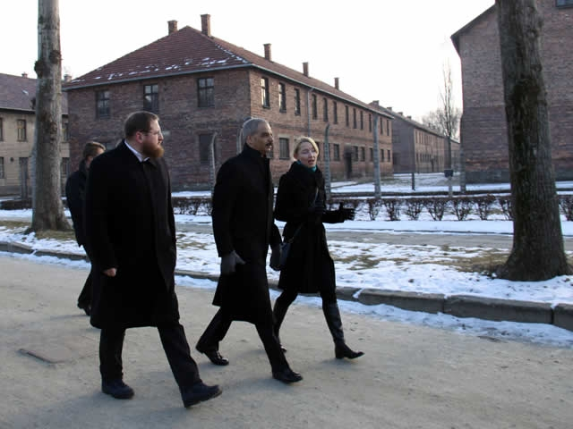 Attorney General Holder, accompanied by the Auschwitz-Birkenau Memorial and State Museum Director Piotr Cywinski, tours the barracks area of the Auschwitz I concentration camp.