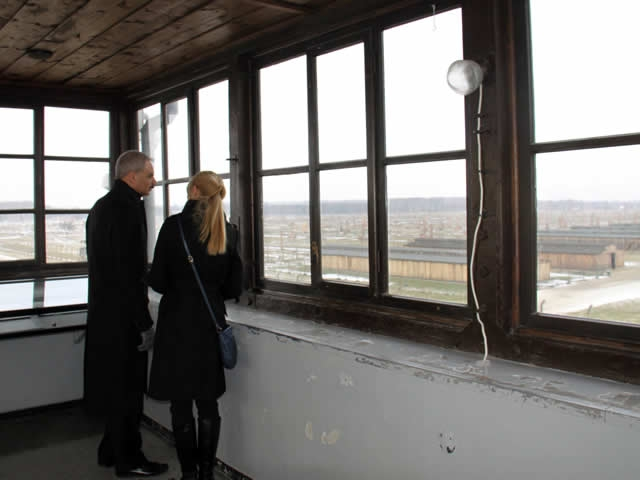 Attorney General Holder, with guide, surveys the Birkenau concentration camp from the watchtower at the the Auschwitz-Birkenau Memorial and State Museum.