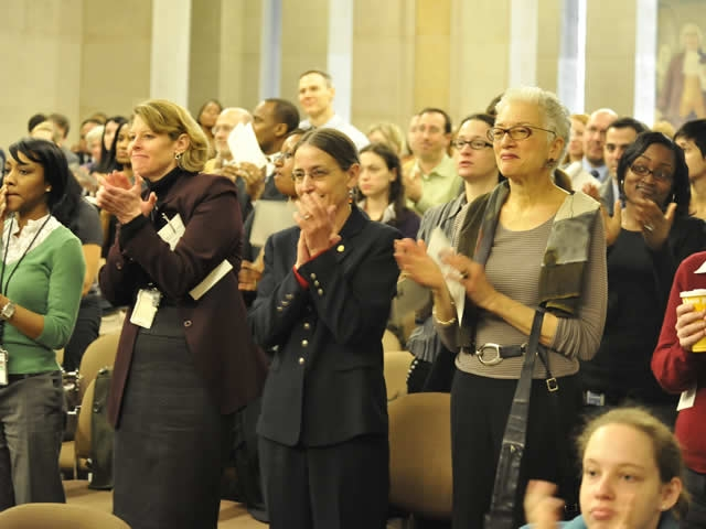 The audience at the event show their appreciation for the expertise and perspectives shared by panel members.