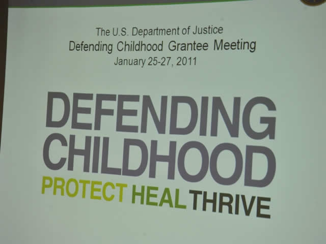 One of the signs directing grantees to the Defending Childhood meeting.