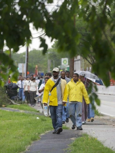 Volunteers walk to new site of the Marvin Gaye Community Greening Center at 50th Street and Nannie Helen Burroughs Ave. N.E.