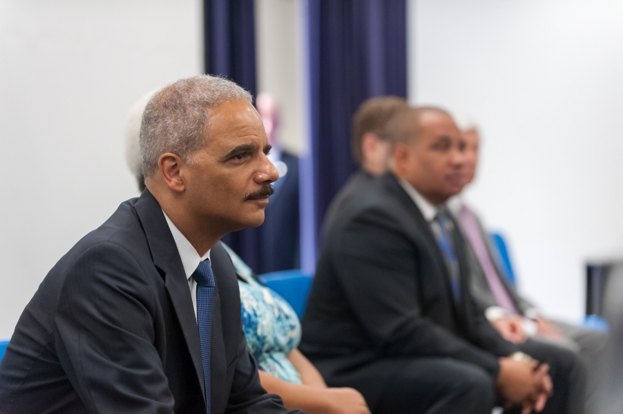 Attorney General Eric Holder listens at a meeting with community leaders organized by the Community Relations Service.