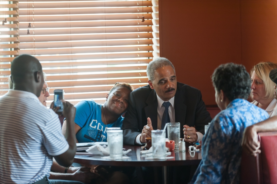 Attorney General Eric Holder speaks with community members at Drake's Place restaurant.