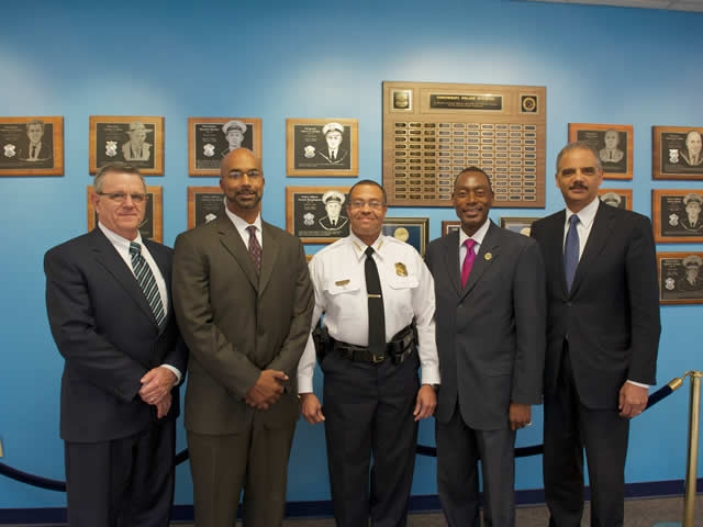 From Left: Director of the Office of Community Oriented Policing (COPS) Bernard Melekian, U.S. Attorney for the Southern District of Ohio Carter M. Stewart, Cincinnati Chief of Police James E. Craig, Cincinnati Mayor Mark Mallory, and Attorney General Eric Holder.
