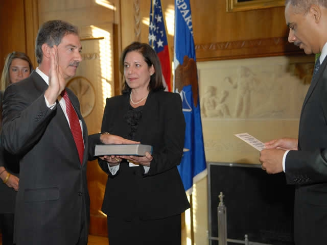 Attorney General Eric Holder administering the oath of office to James Cole the new Deputy Attorney General. The Deputy Attorney General advises and assists the Attorney General in formulating and implementing departmental policies and programs and in providing overall supervision and direction to all organizational units of the Department.