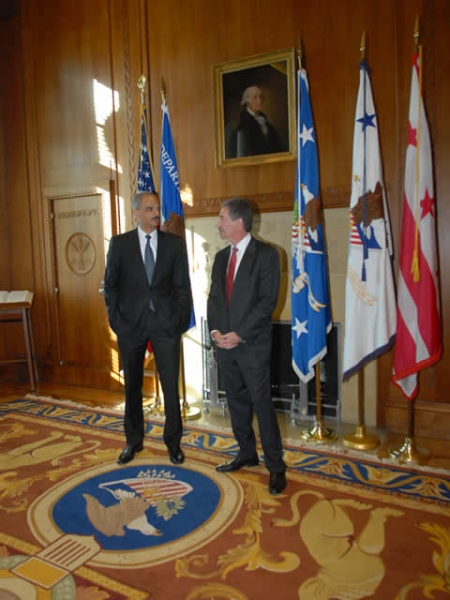 Attorney General Holder and Deputy Attorney General Cole converse and embark upon this new era of the Department's history in the Attorney General's conference room.