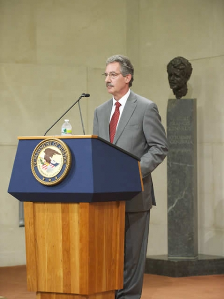 Deputy Attorney General James Cole speaks at the swearing in ceremony.