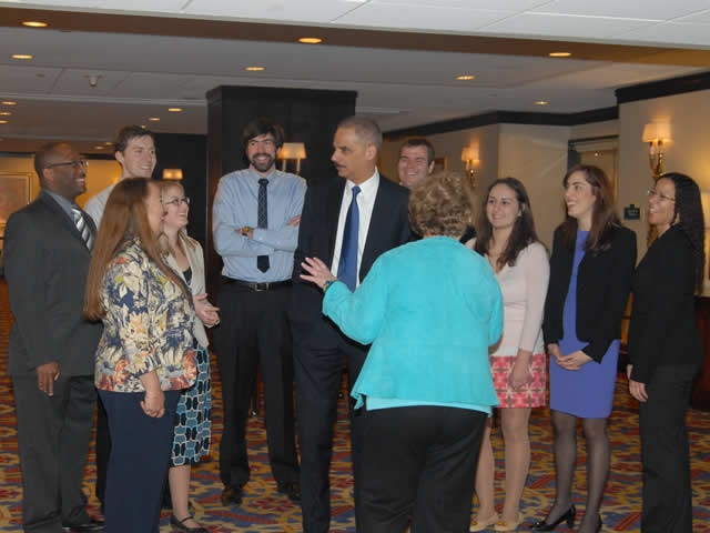 Attorney General Holder chatting informally with attendees of the Pro Bono Institute awards dinner.