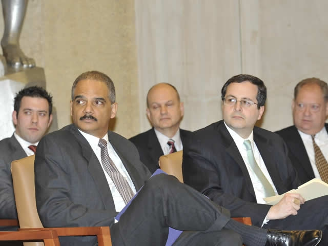 Attorney General Holder and Associate Attorney General Perrelli raptly listen to the speaker.