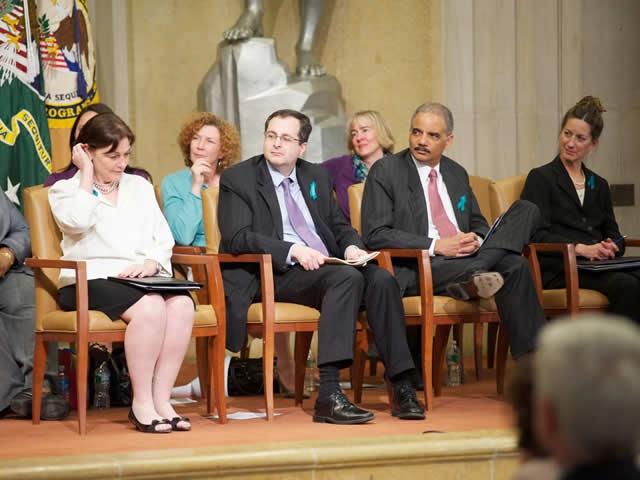 Attorney General Holder, Associate Attorney General Perrelli and other distinguished presenters listen to survivor testimonials.