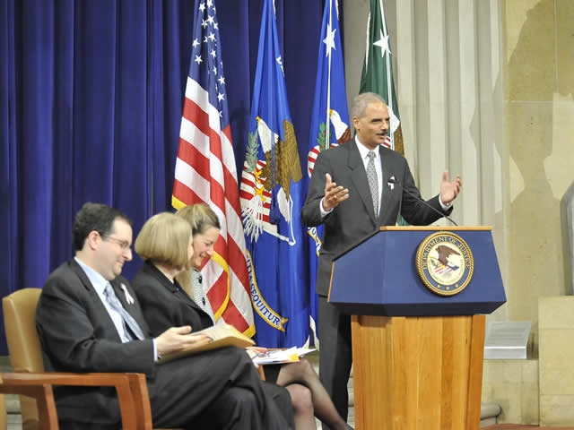 Attorney General Holder welcomes an audience of victim advocates, law enforcement officials, prosecutors, congressional staffers and representatives from national organizations to the 2011 stalking awareness event.