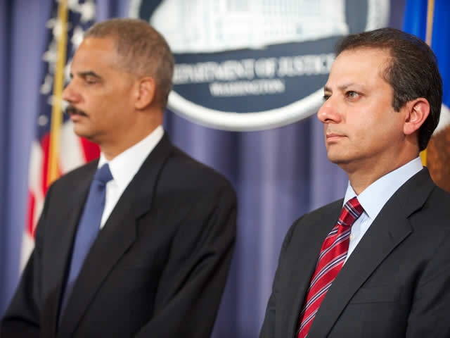 U.S. Attorney for the Southern District of New York Preet Bharara, and Attorney General Eric Holder wait to address the nation.