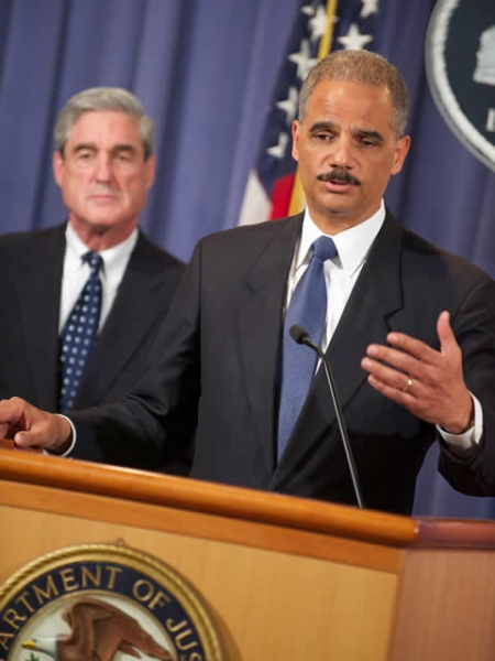 Attorney General Eric Holder explains the alleged assasination plot to members of the media alongside FBI Director Robert Mueller.