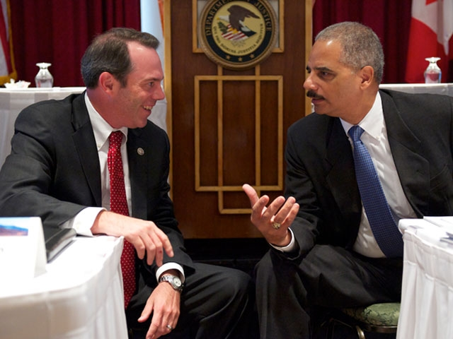 Attorney General Holder speaks with Tim Purdon, the U.S. Attorney for the District of North Dakota.