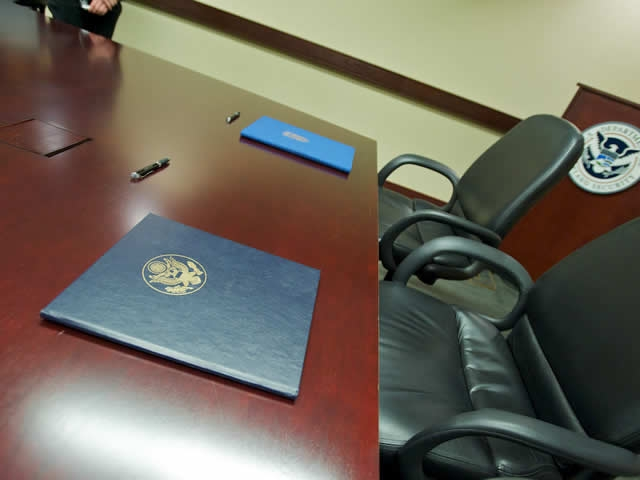 Photo of the two agreements on preventing and combating serious crime await signature in folders.