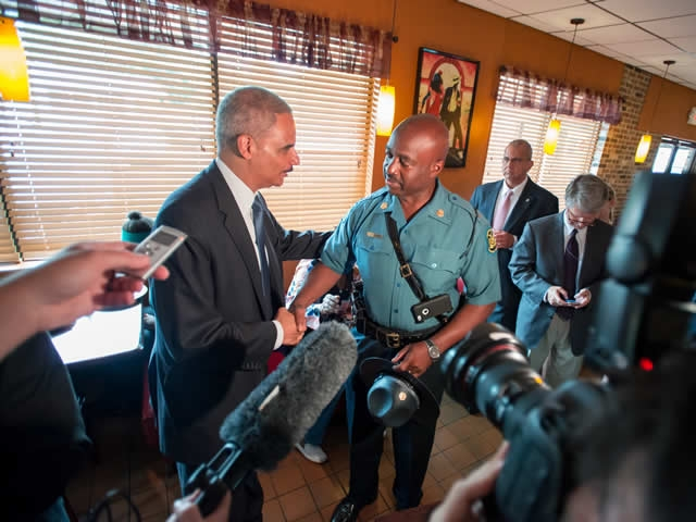 Attorney General Eric Holder meets with Missouri Highway Patrol  Captain Ron Johnson at Drake'€™s Place restaurant.